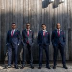 Tailored navy blue suits with red silk ties