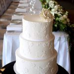 Three- tier coconut cake with white chocolate icing