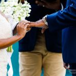 Bride and groom exchange rings in outdoor surprise ceremony