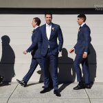 Groom with walking groomsmen