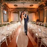 Long reception tables with simple garlands
